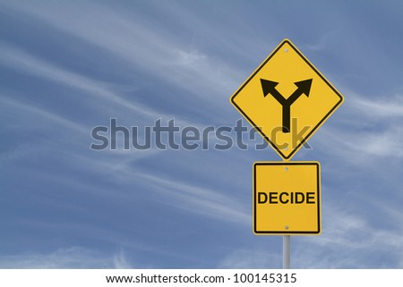 Conceptual road sign on decision making - stock photo