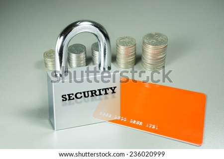Conceptual  security of Credit card isolated on grey background - stock photo