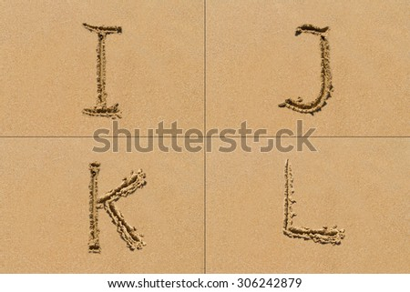 Conceptual set of I J K L letter of the alphabet written on sand with upper case.