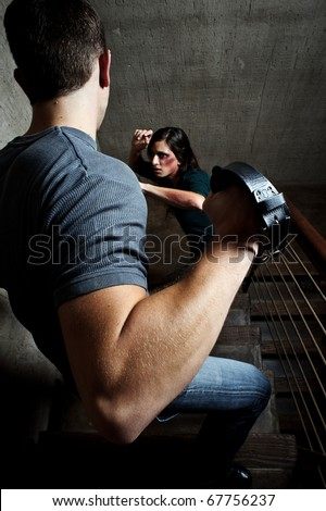 Conceptual shoot of a woman being abused by her partner - stock photo