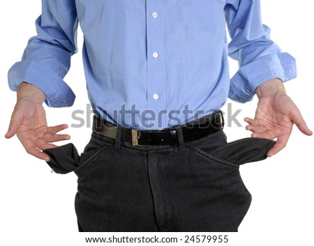 Conceptual shot of business man with empty pockets in tough economic times - stock photo