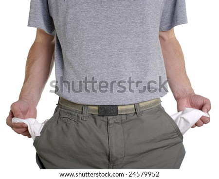 Conceptual shot of man with empty pockets in tough economic times - stock photo