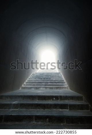 Conceptual shot of staircase in the tunnel with light at the end - stock photo