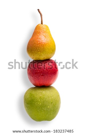 Conceptual shot - you cannot compare apples with pears - stock photo