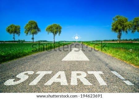 Conceptual Start word painted on asphalt road - stock photo