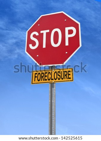 conceptual stop sign with word foreclosure over blue sky - stock photo