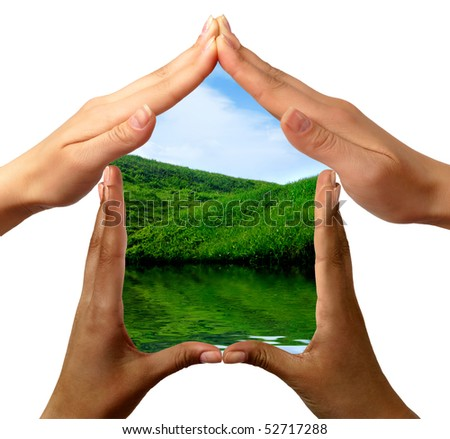 Conceptual symbol home made by black and white people hands framing the nature scenery isolated on white background