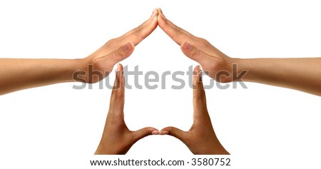 Conceptual symbold home made from black and white hands isolated over white background - stock photo