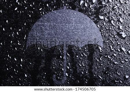 Conceptual umbrella and water drops - stock photo