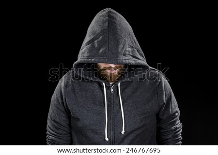Conceptual White Goatee Man Wearing Gray Hood. Isolated on Black Background