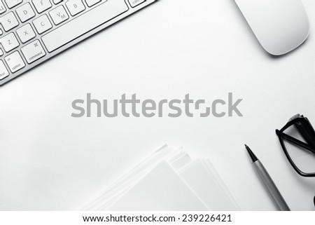 Conceptual White Office Stuffs on Top of White Table with Copy Space for Texts On Upper Right Side. - stock photo