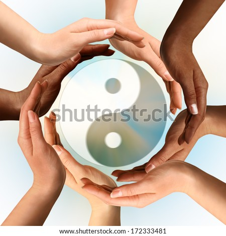 Conceptual yin-yang symbol with multiracial hands surrounding it. Balance, peace, meditation, spirituality concept. - stock photo