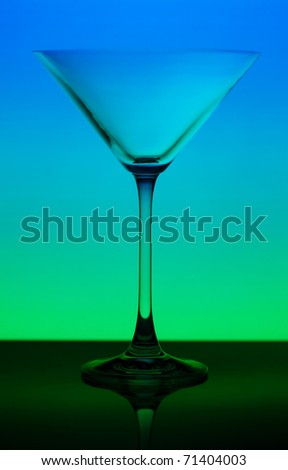 conceptually illuminated martini glass on gradient background