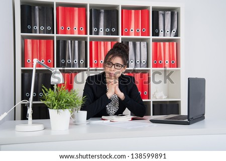 Concerned business woman in the office - stock photo