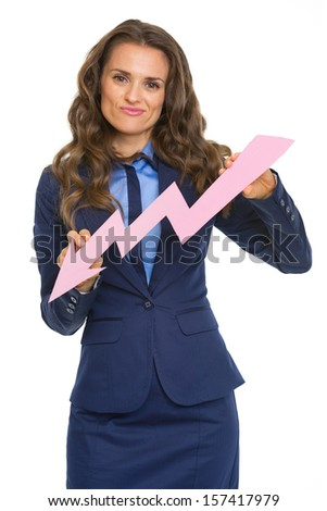 Concerned business woman showing graph arrow going down - stock photo