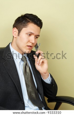 Concerned businessman on the phone - stock photo
