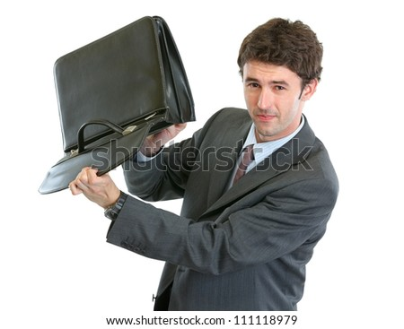 Concerned businessman shakes out something from suitcase