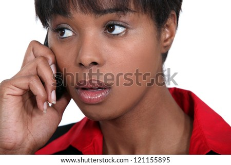 Concerned businesswoman on the phone - stock photo