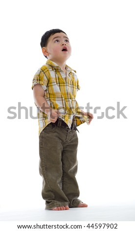 concerned cute boy looking up, isolated on white - stock photo