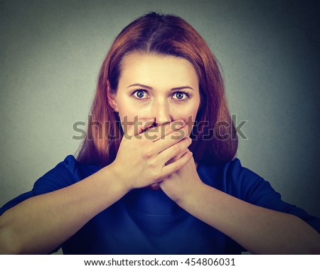 Concerned scared woman covering her mouth with hands  - stock photo