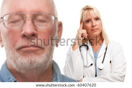 Concerned Senior Man and Female Doctor Behind with Selective Focus the Doctor. - stock photo