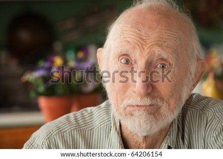 Concerned senior man at home in his house - stock photo