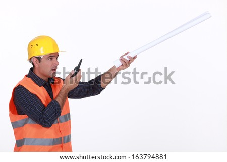 Concerned traffic guard reporting a problem - stock photo
