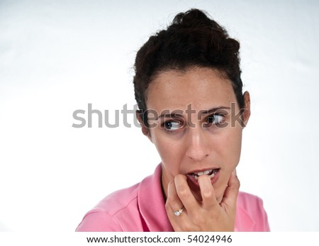 concerned woman, biting her finger - stock photo