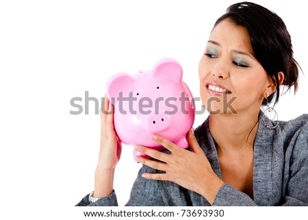 Concerned woman with her savings in a piggy bank - isolated