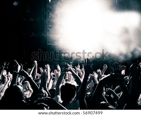 Concert crowd, hands up, toned - stock photo