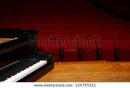 Concert grand piano, view from stage-color version-with space for advertisement - stock photo