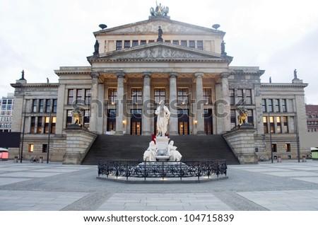 Concert Hall Konzerthaus  in The Gendarmenmarkt Berlin Germany statue of Germany's poet Friedrich Schiller - stock photo