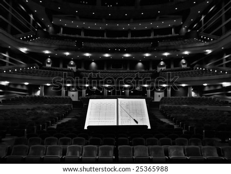 Concert hall with conductor stand, notes and baton - stock photo