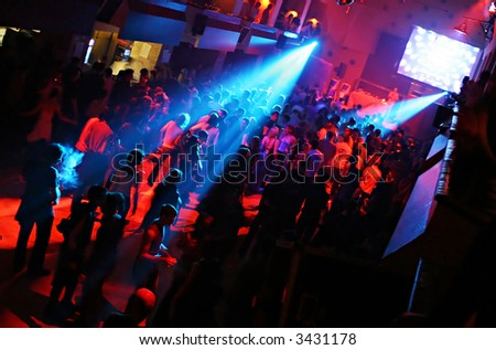 Concert Party at the Disco Full of People - stock photo