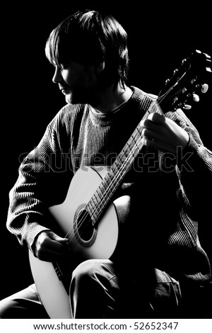 Concert. Silhouette of guitarist isolated on black background. Black and white photo of classical acoustic guitar player - stock photo