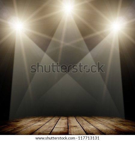 concert spot lighting over dark background and wood floor - stock photo