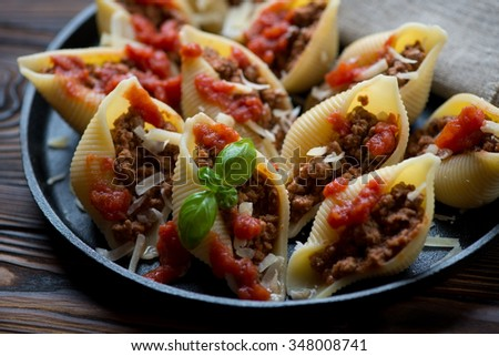 Conchiglioni stuffed with bolognese sauce, selective focus