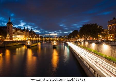 Conciergerie by night, Paris, France - stock photo