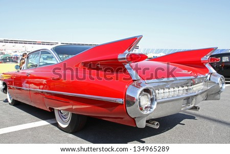 CONCORD, NC - APRIL 6:  A 1959 Cadillac automobile on display at the Food Lion Auto Fair classic car show at Charlotte Motor Speedway in Concord, NC, April 6, 2013. - stock photo