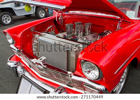 CONCORD, NC -- APRIL 11, 2015:  A 1956 Chevy hot rod automobile on display at the Charlotte AutoFair classic car show held at Charlotte Motor Speedway. - stock photo