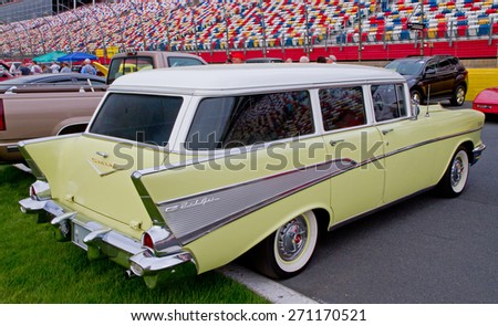 CONCORD, NC -- APRIL 11, 2015:  A 1957 Chevy station wagon automobile on display at the Charlotte AutoFair classic car show held at Charlotte Motor Speedway. - stock photo