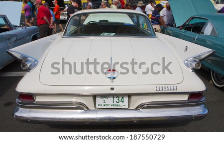 CONCORD, NC -- APRIL 05, 2014:  A 1961 Chrysler 300 automobile on display at the Charlotte AutoFair classic car show held at Charlotte Motor Speedway. - stock photo