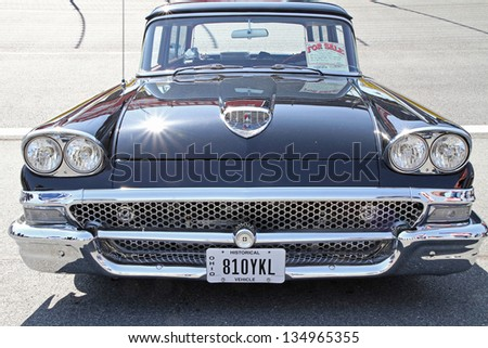 CONCORD, NC - APRIL 6:  A 1958 Ford automobile on display at the Food Lion Auto Fair classic car show at Charlotte Motor Speedway in Concord, NC, April 6, 2013. - stock photo