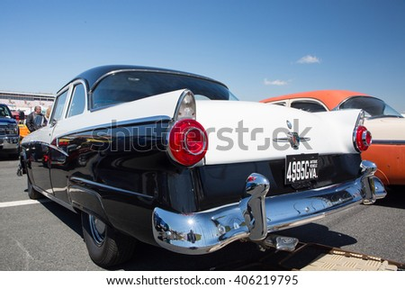 CONCORD, NC - APRIL 8, 2016:  A 1956 Ford automobile on display at the Pennzoil AutoFair classic car show held at Charlotte Motor Speedway. - stock photo