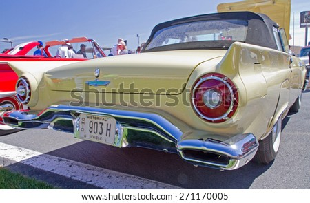 CONCORD, NC -- APRIL 11, 2015:  A 1957 Ford Thunderbird automobile on display at the Charlotte AutoFair classic car show held at Charlotte Motor Speedway. - stock photo