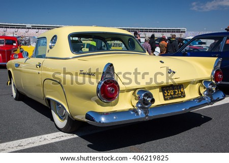 CONCORD, NC - APRIL 8, 2016:  A 1955 Ford Thunderbird automobile on display at the Pennzoil AutoFair classic car show held at Charlotte Motor Speedway. - stock photo
