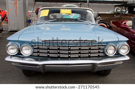 CONCORD, NC -- APRIL 11, 2015:  A 1960 Oldsmobile Super 88 convertible automobile on display at the Charlotte AutoFair classic car show held at Charlotte Motor Speedway. - stock photo