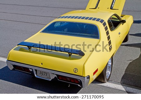 CONCORD, NC -- APRIL 11, 2015:  A 1971 Plymouth Roadrunner automobile on display at the Charlotte AutoFair classic car show held at Charlotte Motor Speedway. - stock photo