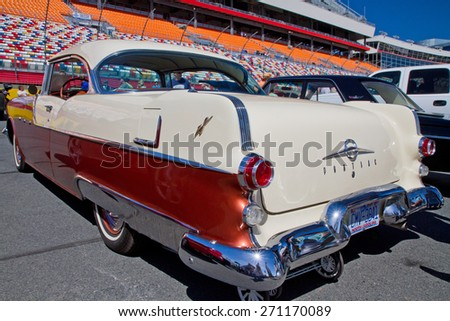 CONCORD, NC -- APRIL 11, 2015:  A 1955 Pontiac Chieftain automobile on display at the Charlotte AutoFair classic car show held at Charlotte Motor Speedway. - stock photo