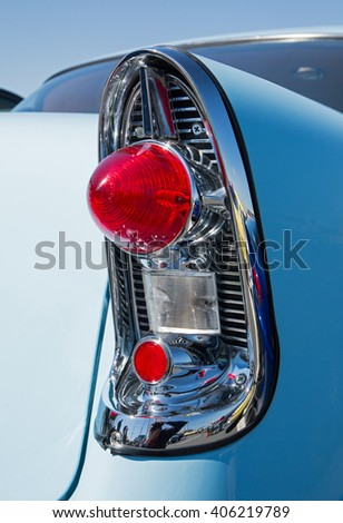 CONCORD, NC - APRIL 8, 2016:  Closeup of a 1956 Chevrolet tail light on display at the Pennzoil AutoFair classic car show held at Charlotte Motor Speedway. - stock photo